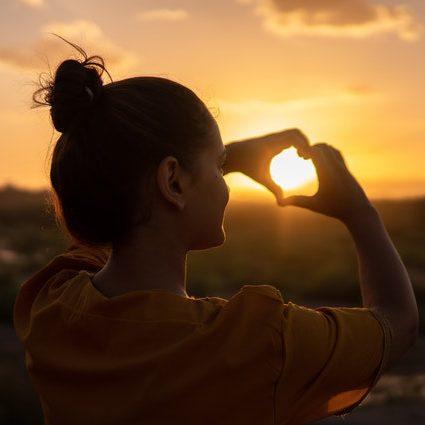 Herz vor einem Sonnenuntergang